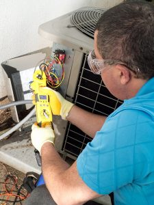 hvac-technician-performing-air-conditioner-repair