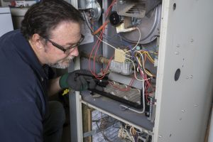 technician-inspecting-furnace